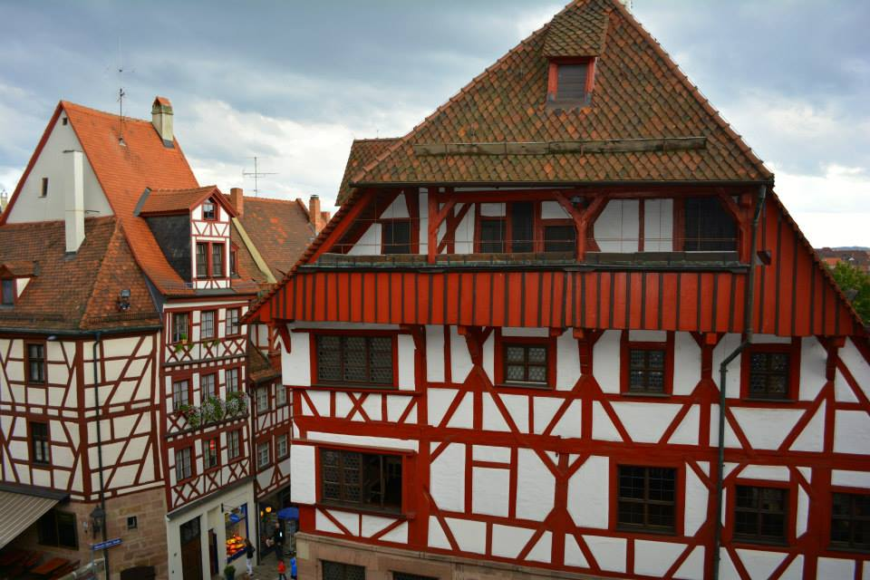 Albrecht Durer House, with dark rust-orange half-timber work