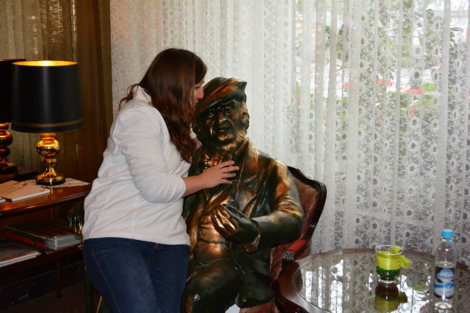 Encore Tours' Tori Cook hugging a sitting bronze statue of Wagner