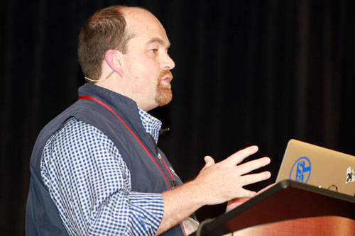 Travis Warren speaking at a User Conference.