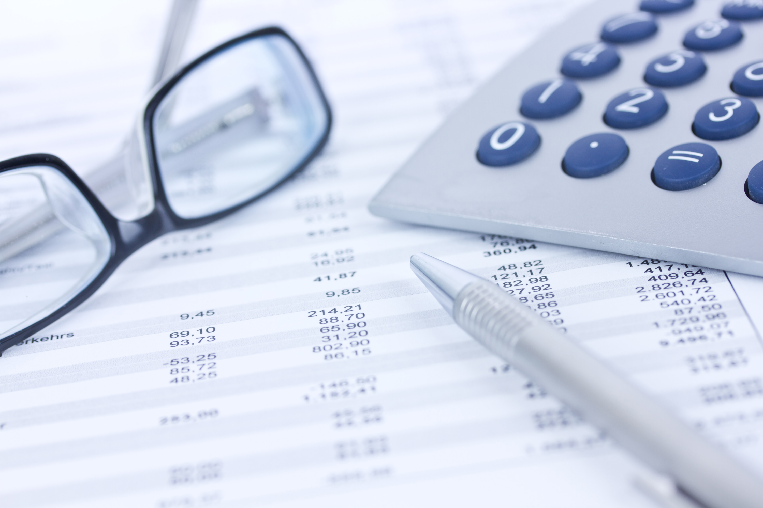 glasses and a calculator for looking for check fraud in accounts payable
