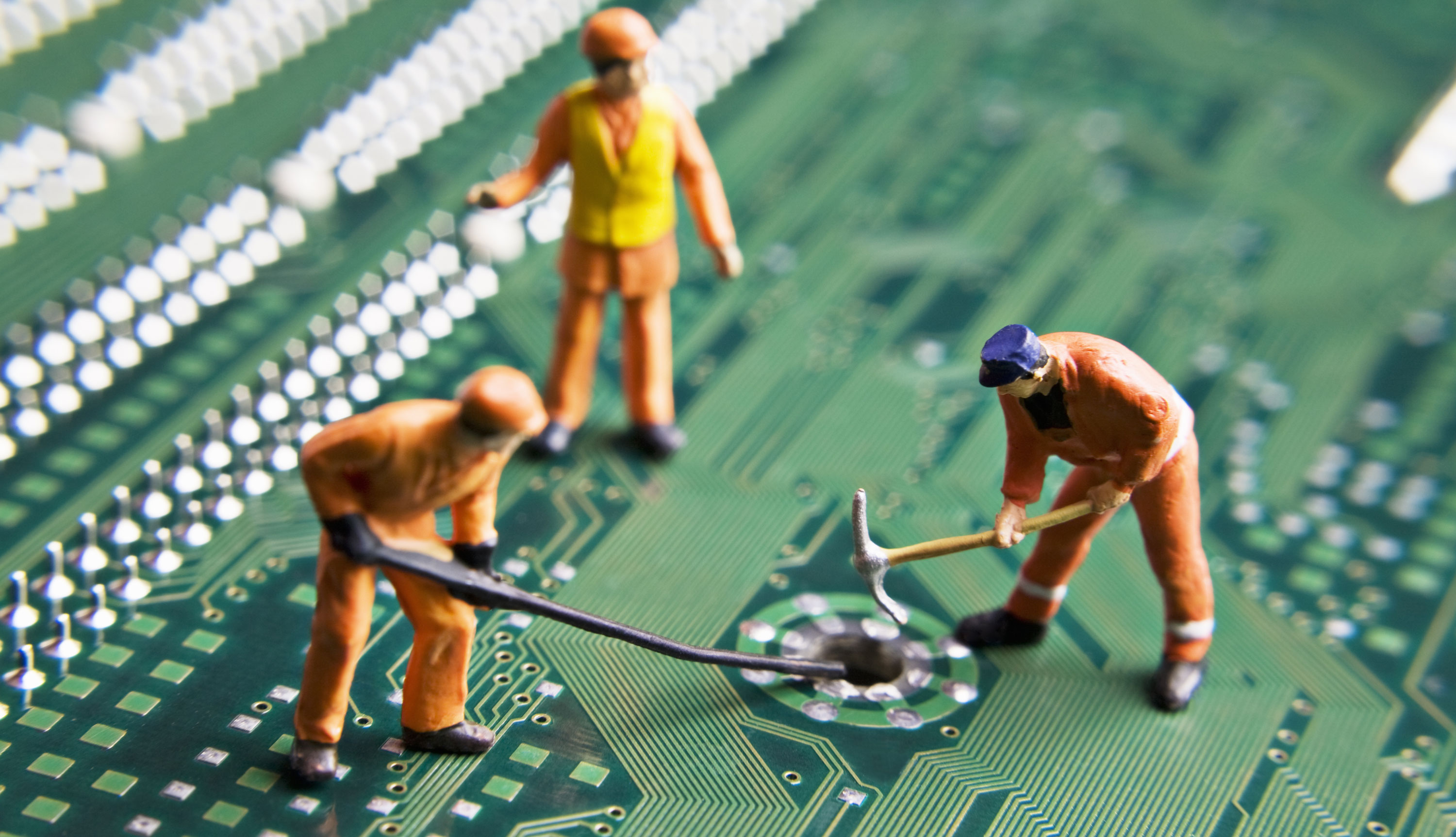 construction figurines work on a circuit board