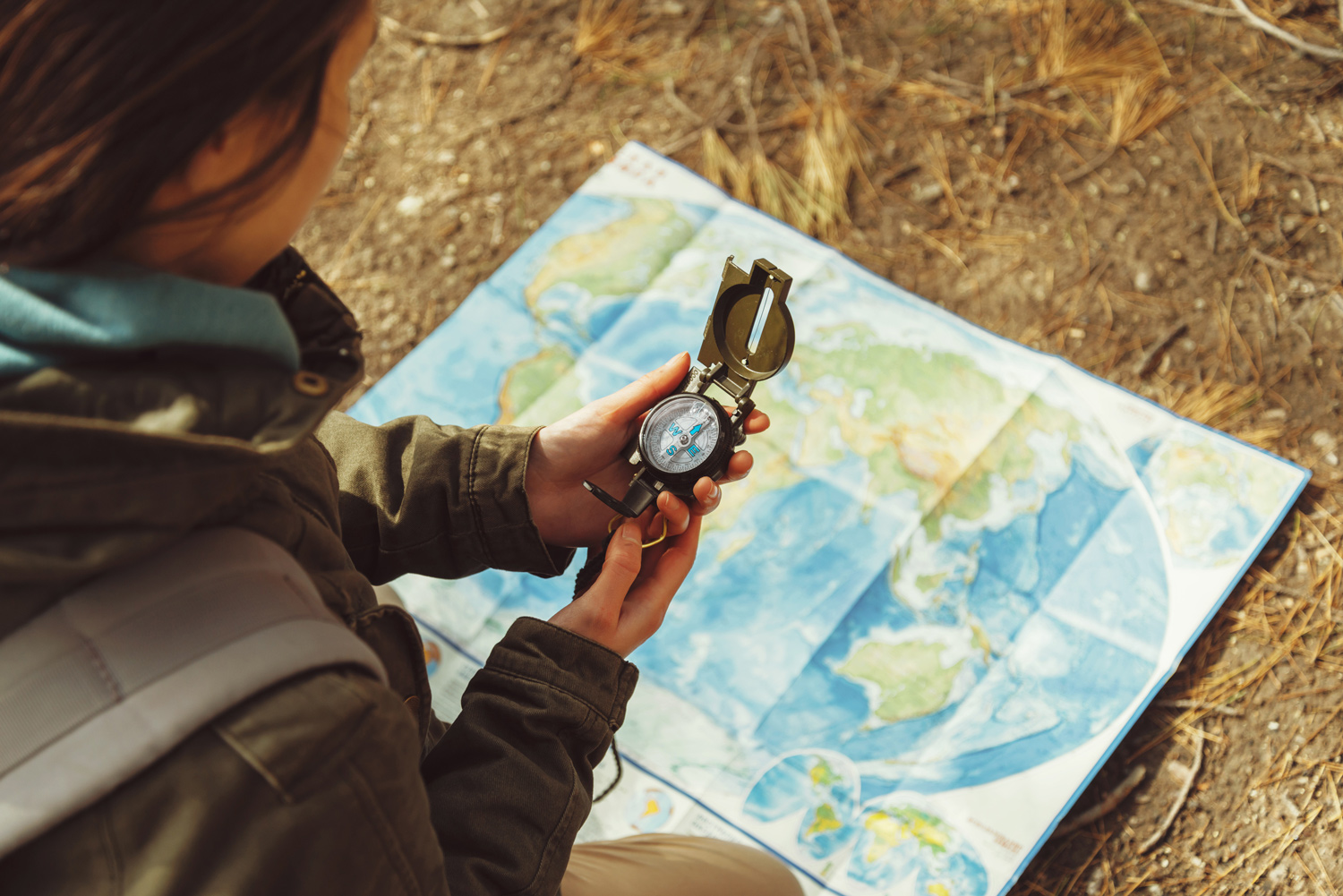 woman with compass and world map
