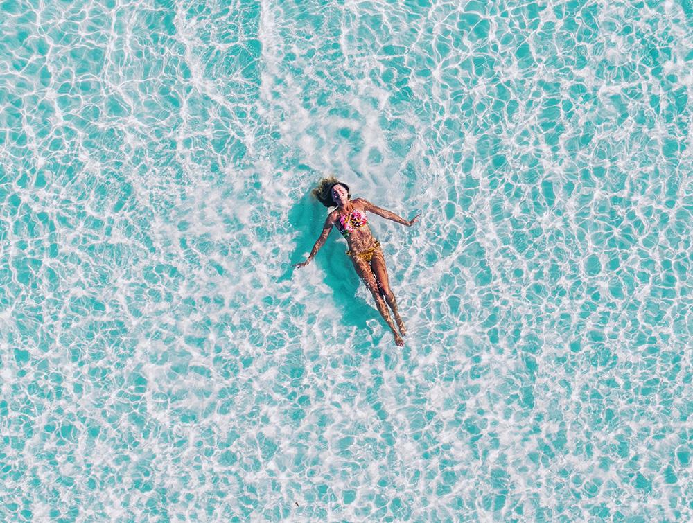woman in bikini in the pool