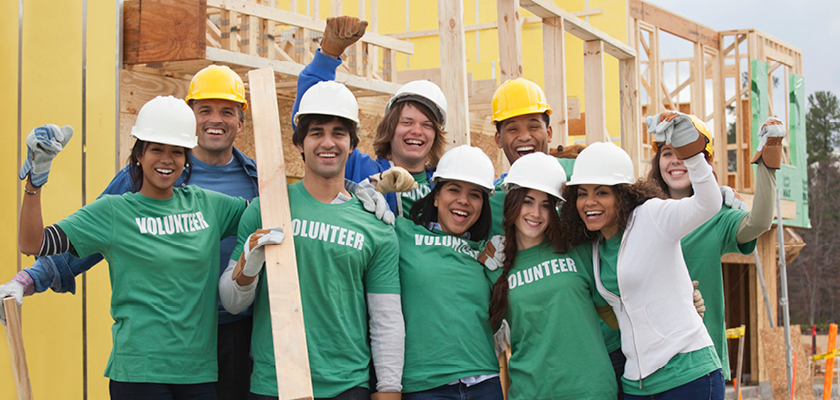 Nine volunteers of all races working at construction site