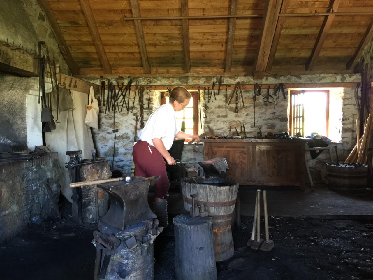 Natasha Juckes works at a forge at the Fortress of Louisbourg National Historic Site, which is a reconstruction of an 18th century town.
