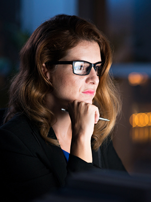 Woman thinking about how much solar panels for business cost