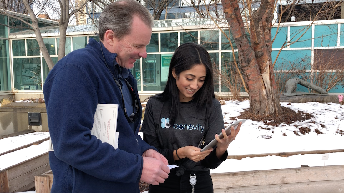 Benevity-ite, Komal gives a $25 charitable gift card to Randy, who happened to be in the right place at the right time!