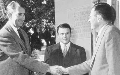 Photo of David Packard and William Hewlett with Frederick Terman