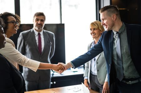 Couple Shaking Hands in Business Setting