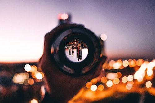 telescope on cityscape