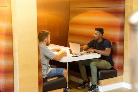 two men working at a desk