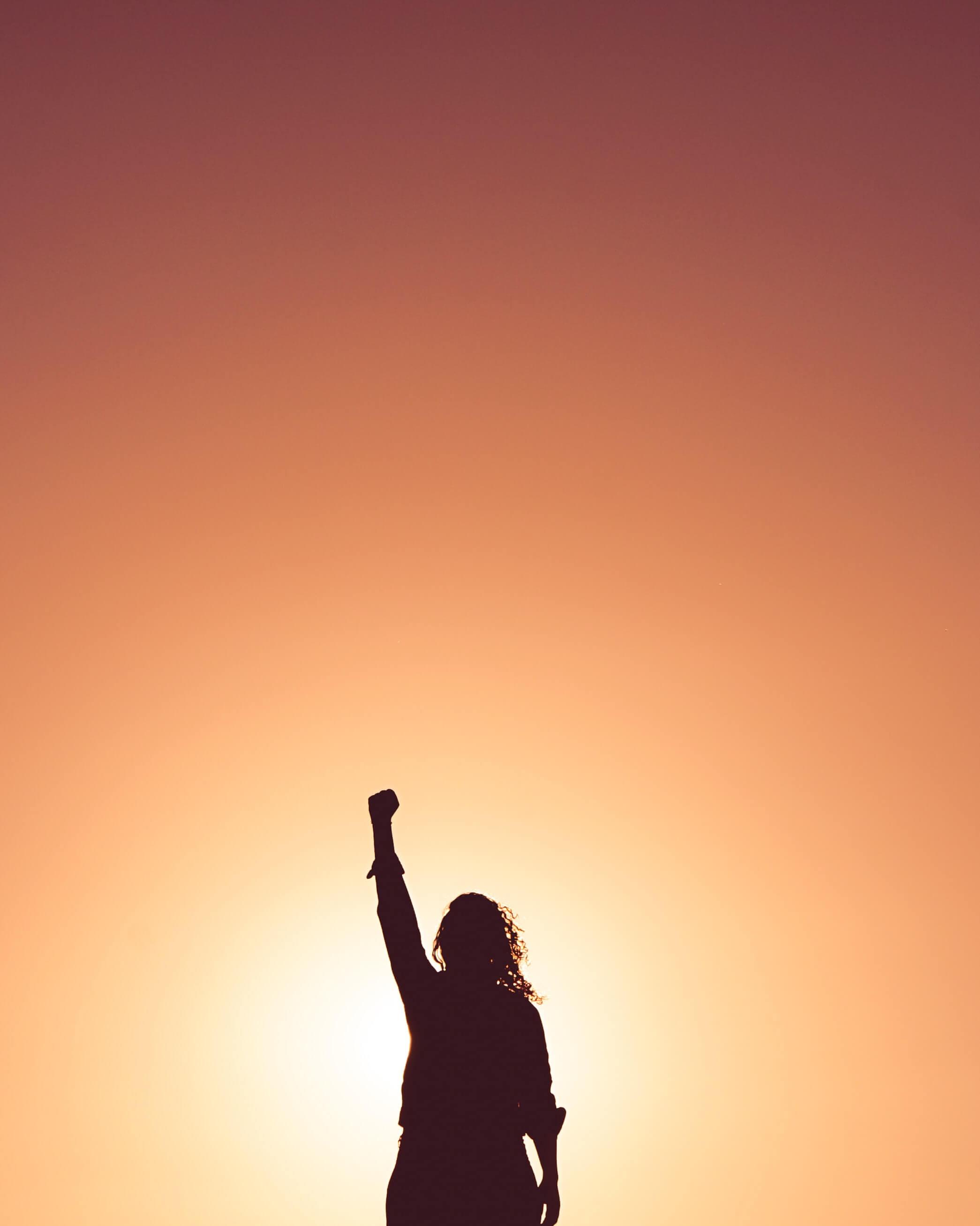 woman celebrating in the sun