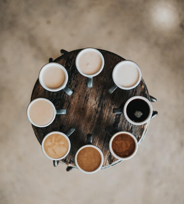cups of coffee with different amounts of cream