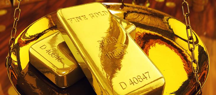 Fine gold bricks in a suspended golden bowl.