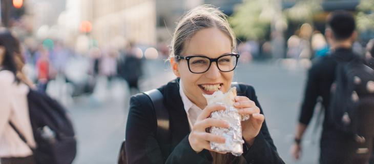 Happy girl eating burrito
