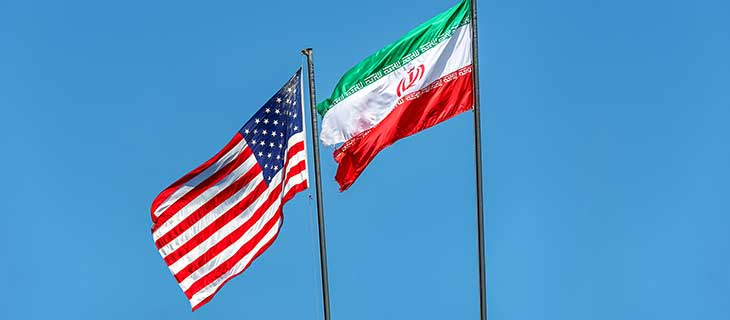 Iran and United-States flags flowing in the wind.