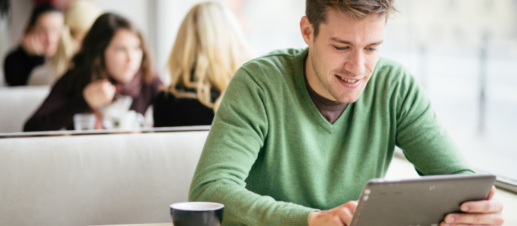 young man looking at tablet
