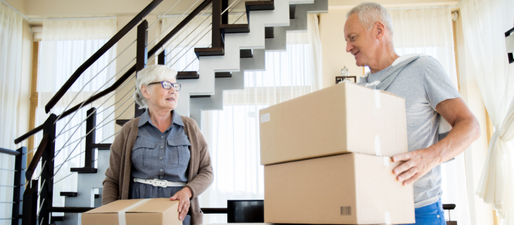 An elder couple moving into a new home.
