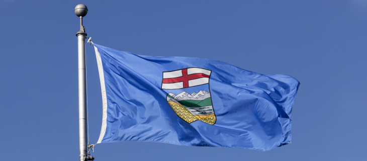 Alberta flag blowing in the wind.