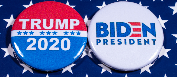 Two election pins writing Trump on one and Biden on the other.
