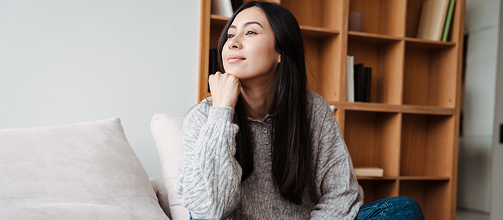 A content woman gazing in the air.