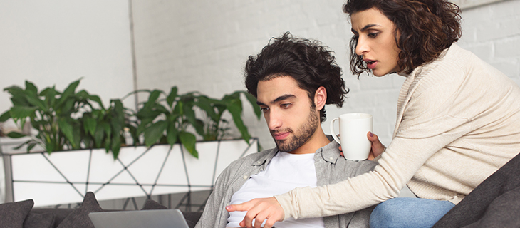 Young couple looking at laptop screen together