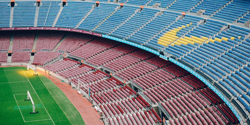 Nike logo on chairs at a stadium