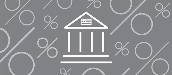 Une iconographie de la réserve fédérales entouré des symbole de pourcentage.