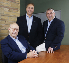 Company founder Fred Rottler (left), with his sons, Mike (center) and Gary, in 2002