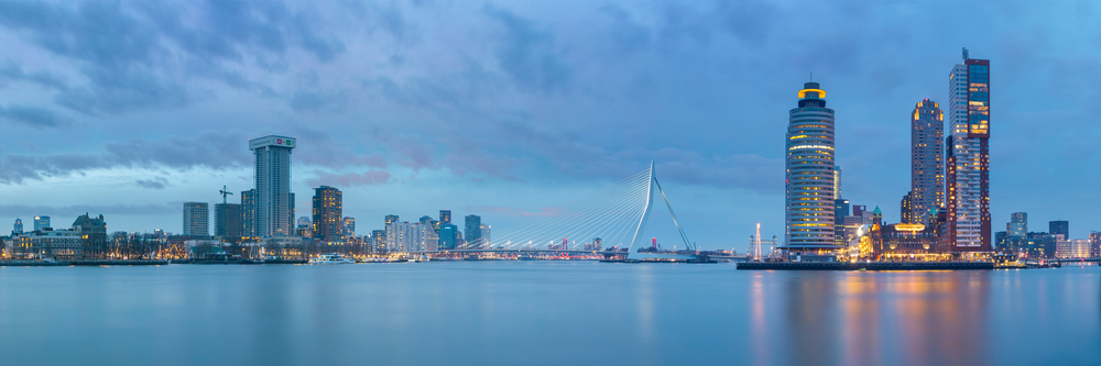 Panoramic view of the Rotterdam skyline, with the De Zalmhaven Tower complex featured on the right