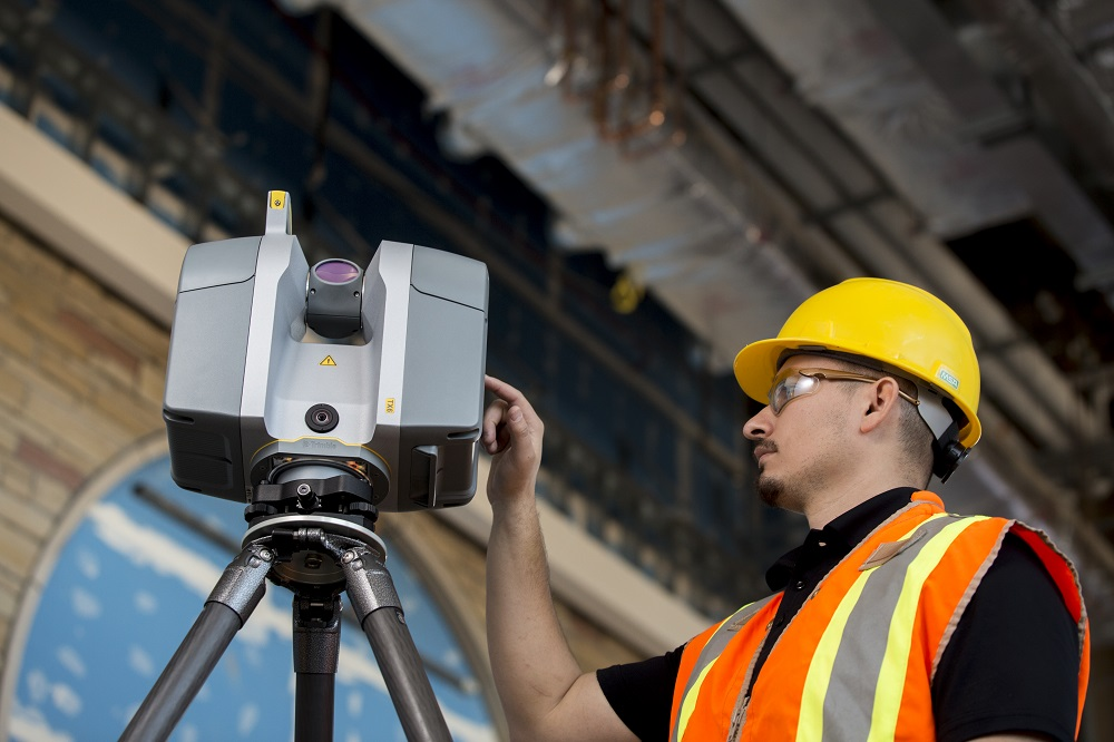 Construction worker uses X7 scanner to perform qa on the jobsite