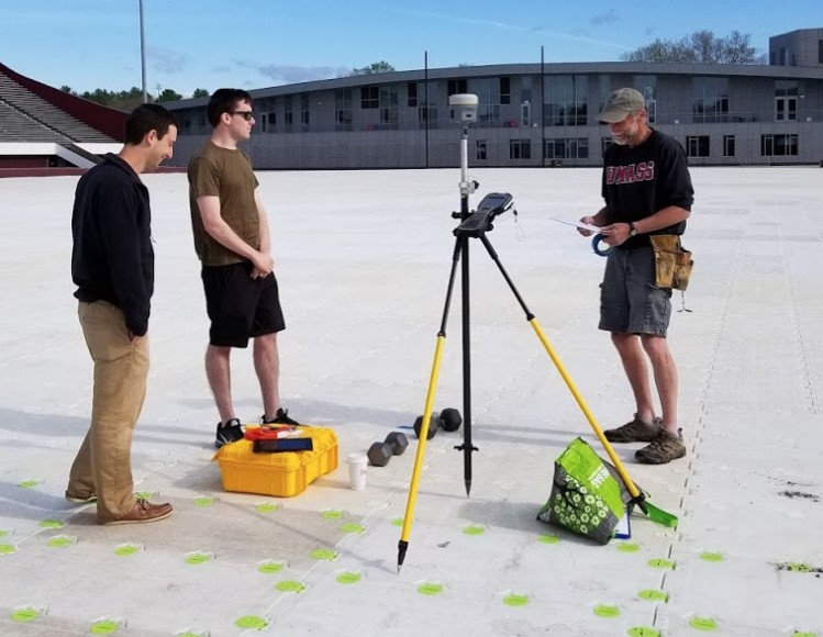 UMass students using Trimble R10 to layout for commencement event