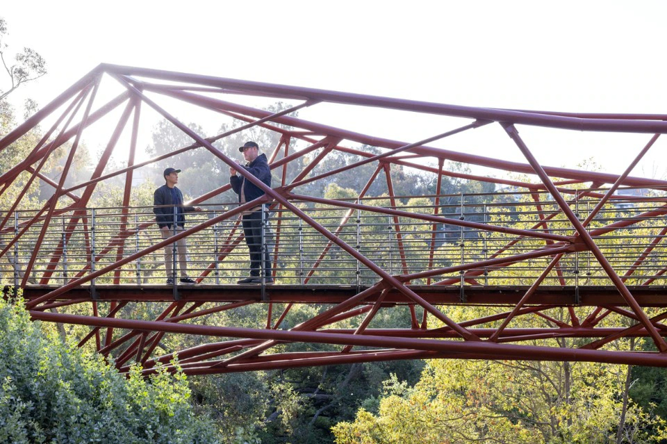A student helps on construction of the Ponte Arroyo bridge in Los Angeles