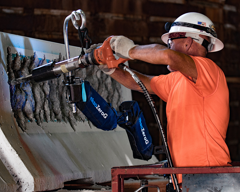 construction worker uses eskobionics eksozerog to demo concrete wall