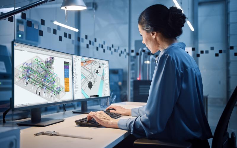 Woman looking at a 3D BIM model on her desktop computer