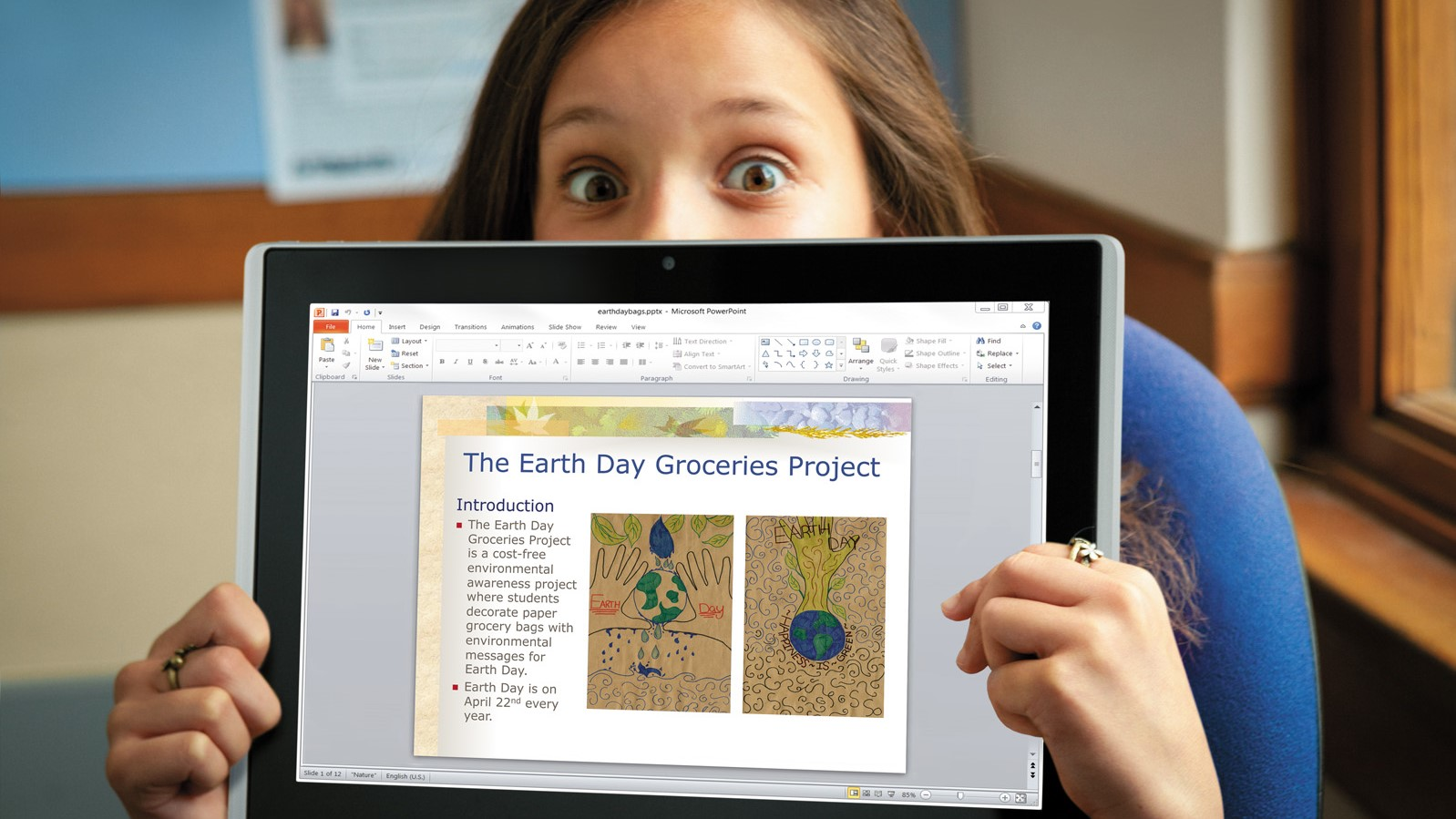A student shows off their Earth Day project on a Windows 10 device