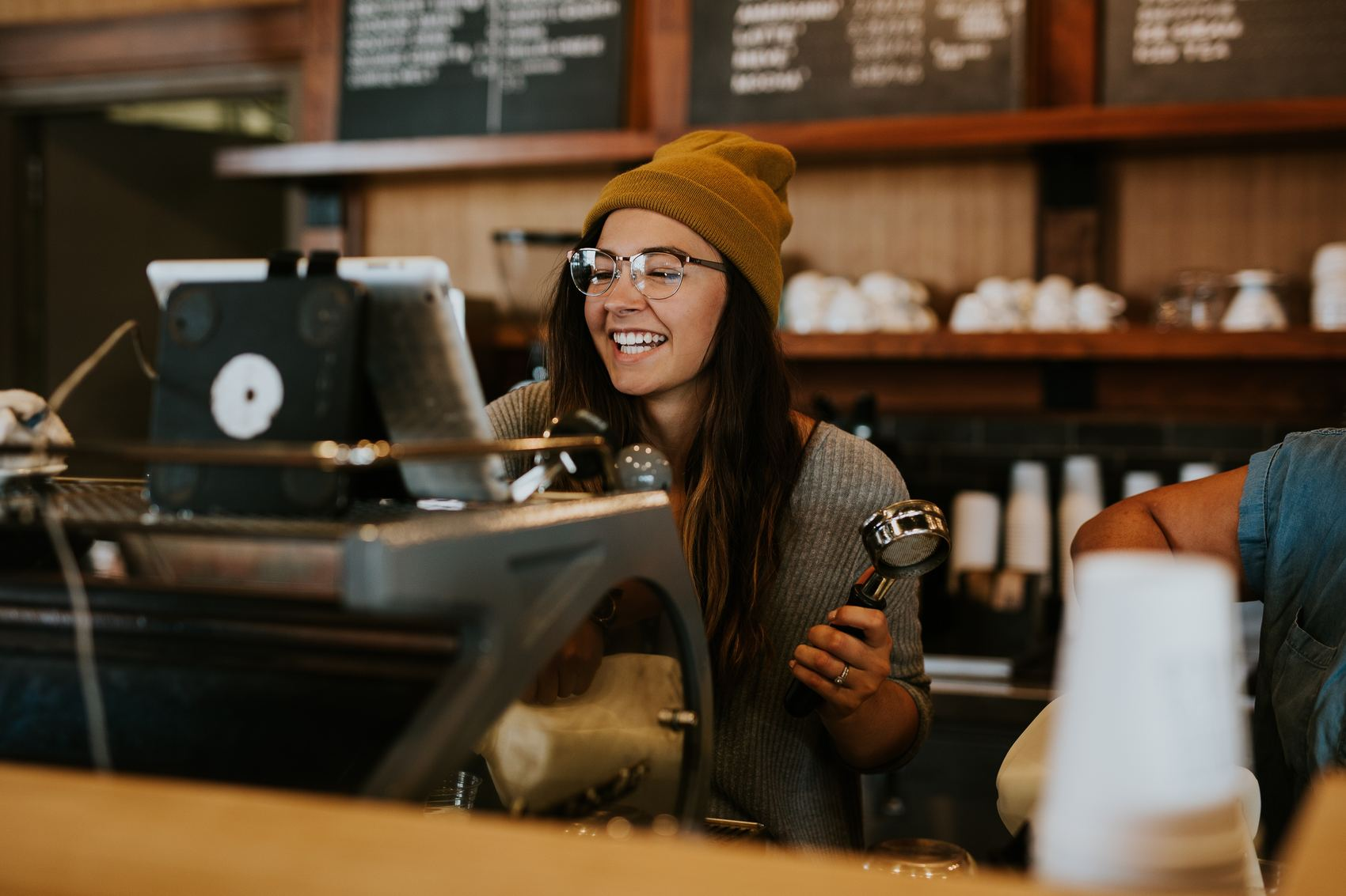 Barista smiling after a good employee onboarding process