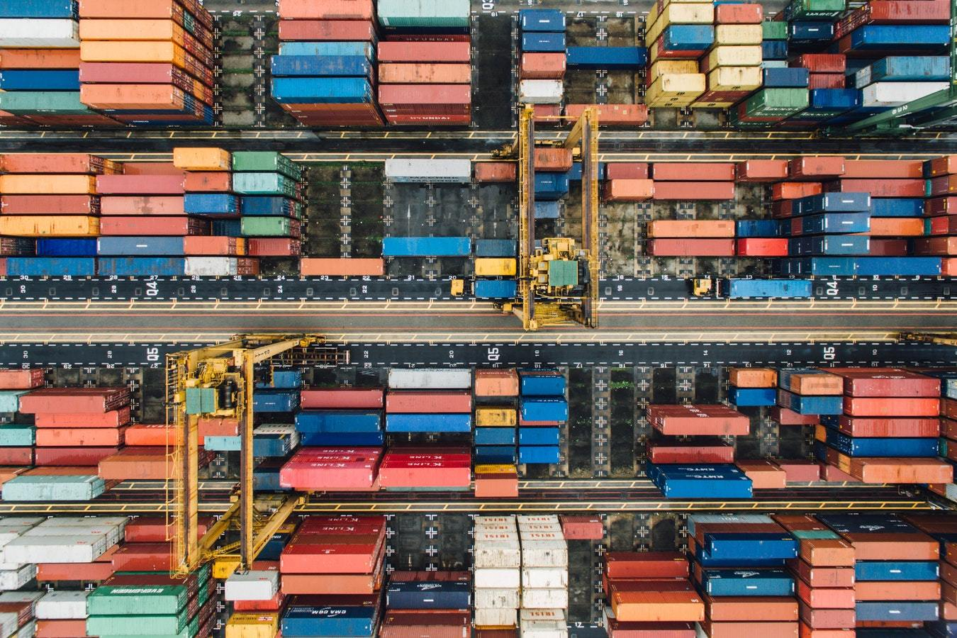 Stacked colorful cargo containers to demonstrate the capabilities of the Salesforce Streaming API