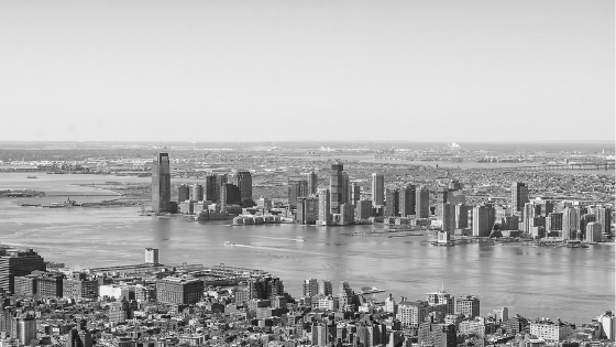 Black and white aerial photo of New York City, including its iconic retailers