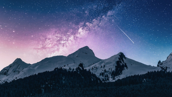 Mountain against a purple sky and a shooting star in Italy