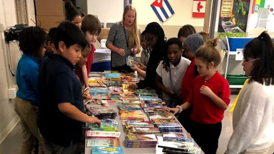 Children lining up to select donated books at the Appirio and First Book event