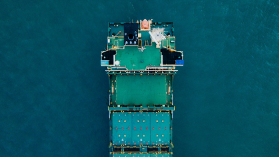 Blue and teal cargo containers on a large ship showcasing smart supply chains and logistics