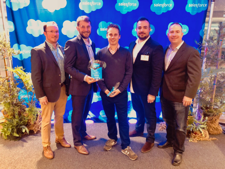Appirio and Ashfield team members winning a Salesforce award
