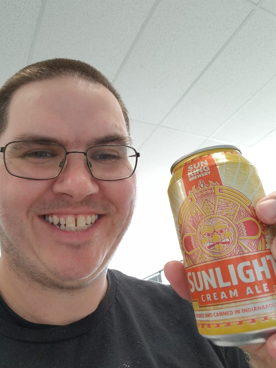 Bon Jones It Specialist at Appirio holding a Sunlight brand beer can