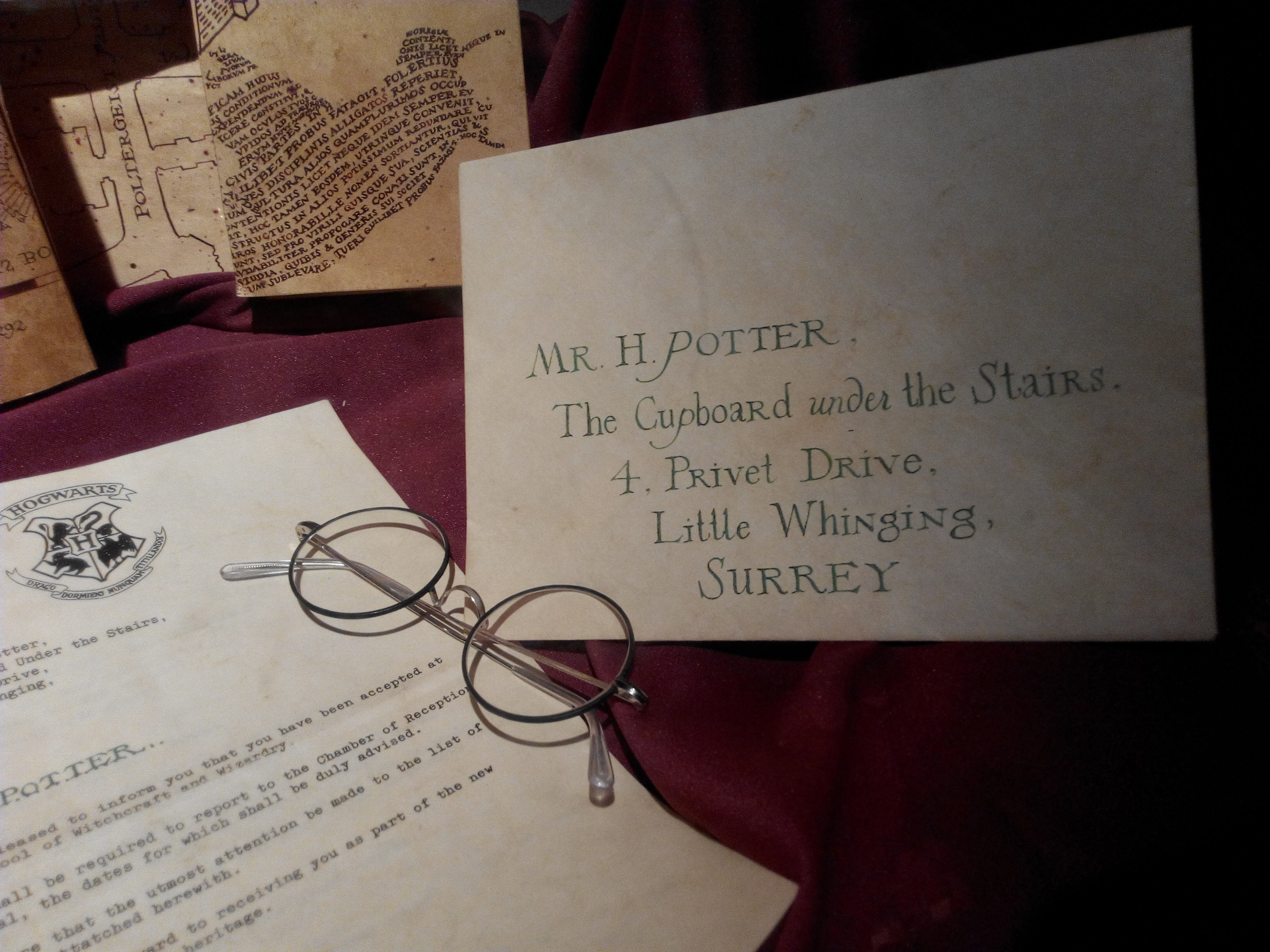 Harry Potter acceptance letter, glasses, and envelope