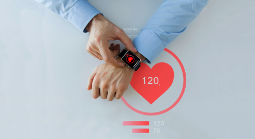 Wearable device on a man's wrist tracking heart rate and activity data on Salesforce Health Cloud
