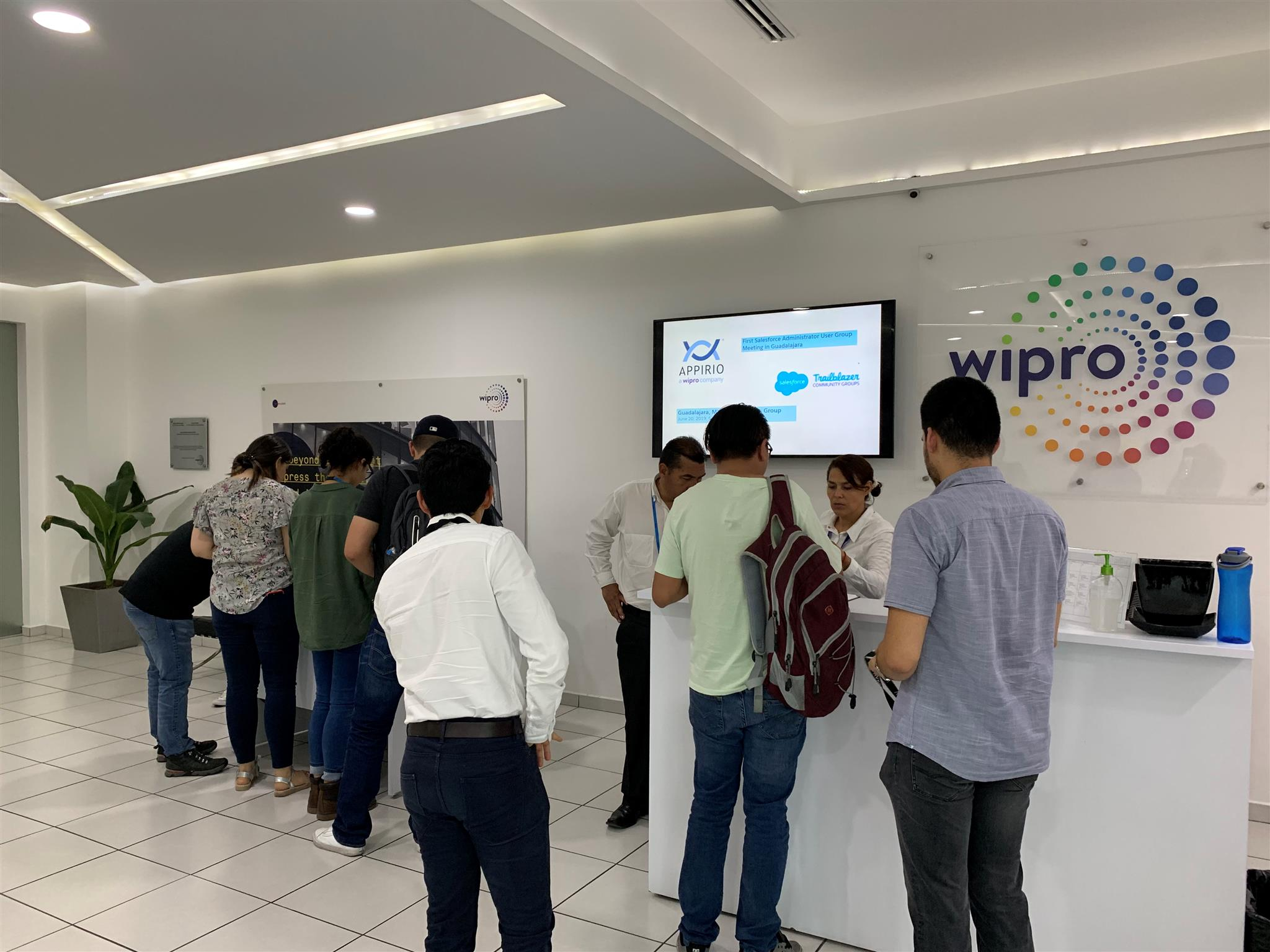 Appirio and Wipro logo and a group of attendees at the Meet-Up in Guadalajara