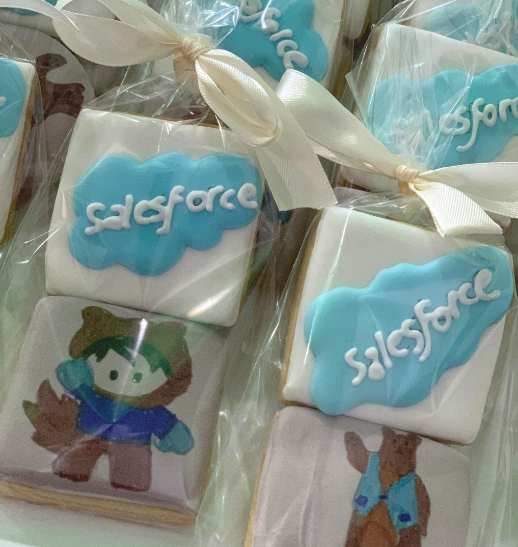 Salesforce cookies with Salesforce logos and mascots in individual packages with white bows