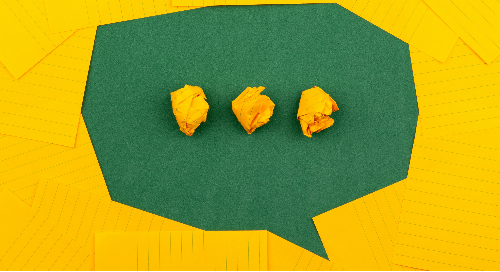 Speech bubbles with crumbled yellow and green paper