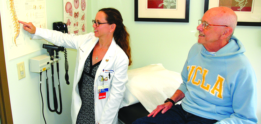 Dr. Barbara Lazio talks with Bob Nakutin about his procedure during a recent follow-up appointment.